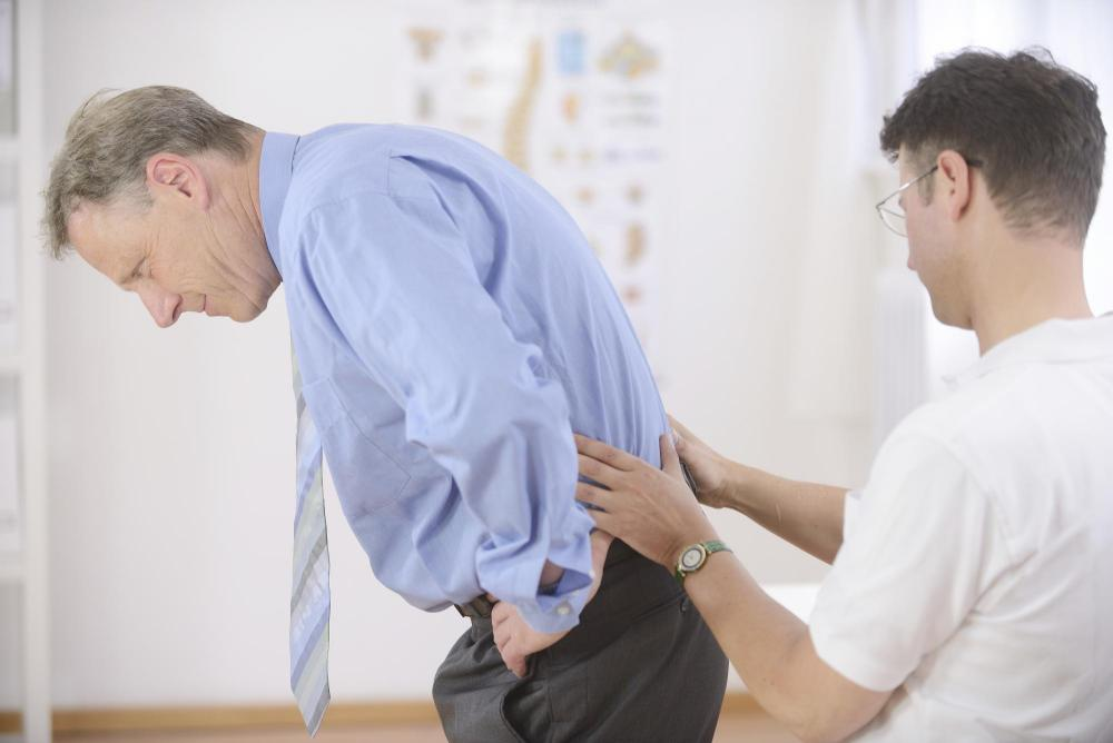 man getting a chiropractic adjustment in Wilmington